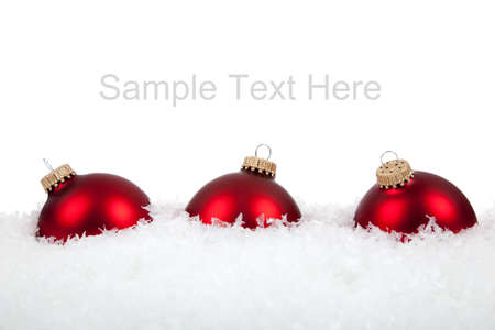 Red Christmas ornamentsbaubles on a white background with copy space Stock Photo