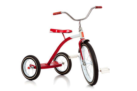 nostalgic: A childs red tricycle on a white background