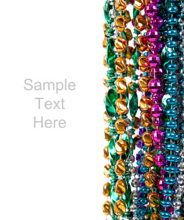 colorful beads: Multi colored mardi gras beads including blue, green, purple, pink, yellow and gold on a white background with copy space