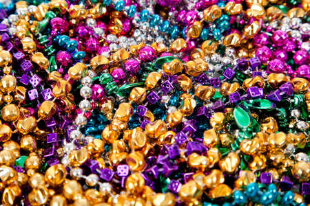 colorful beads: Background made up of mulit-colored including gold, purple, blue, green and pink mardi gras beads