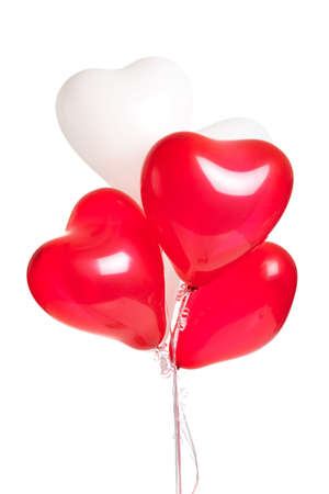 A bouquet of red and white heart balloons on a white background photo