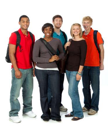 Teenagers studying: Un grupo multirracial de estudiantes universitarios sobre un fondo blanco Foto de archivo