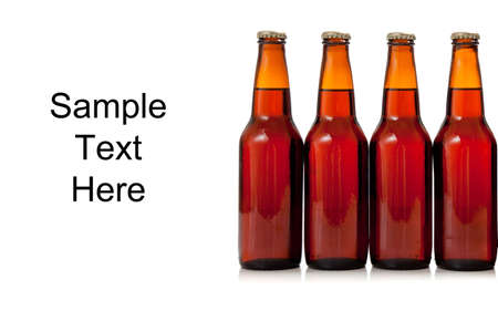 Four brown bottles of beer on white with copy space