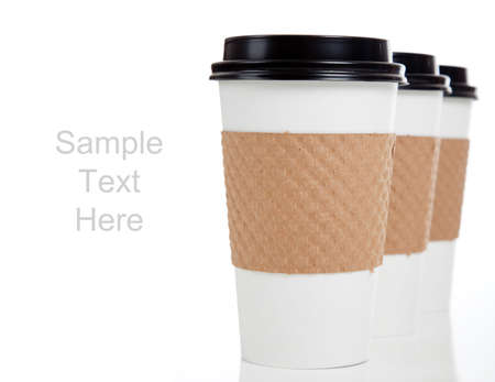A row of paper coffee cups on a white background with copy space