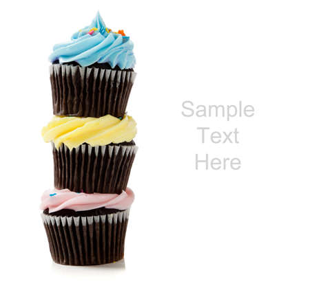Pastel cupcakes including blue, pink and yellow on a white background with copy space Stock Photo - 6756388