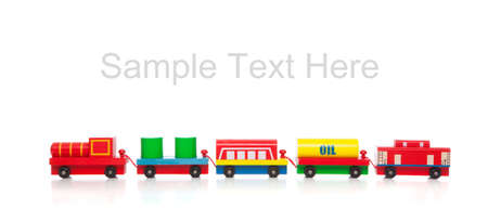 caboose: a wooden toy train on a white background with copy space