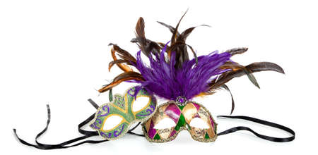 Purple, green and gold mardi gras masks on a white background 스톡 콘텐츠