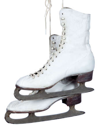 iceskating: A pair of white ice skates on a white background with copy space