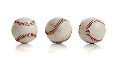Three baseballs with red thread on a white background Stock Photo - 6756437