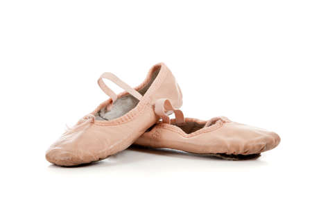 Small pink ballet slippers on a white background