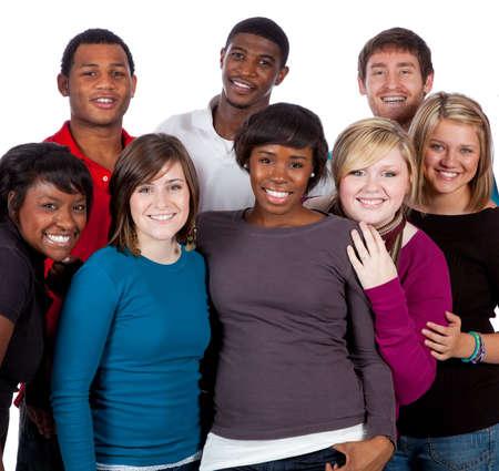 diversidad: Un grupo multirracial de estudiantes universitarios sobre un fondo blanco Foto de archivo