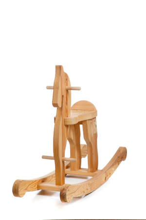 A wooden rocking horse on a white background with copy space photo