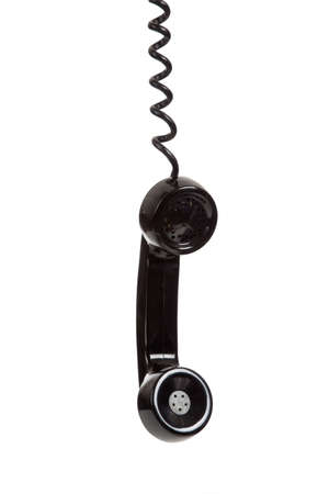 receiver: A singel black telephone receiver hanging with a white background