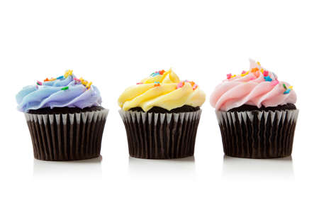 chocolate cupcakes: Pastel chocolate cupcakes including pink, blue and yellow on white