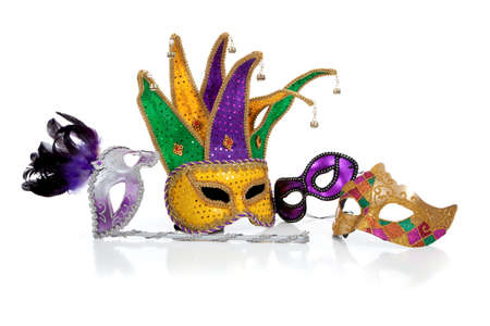 Assorted mardi gra masks including gold, purple and green on a white background photo