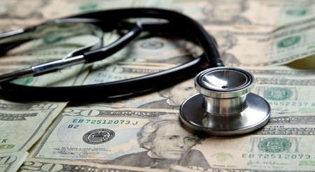 health reform: A stethoscope on a background made of $20 bills Stock Photo