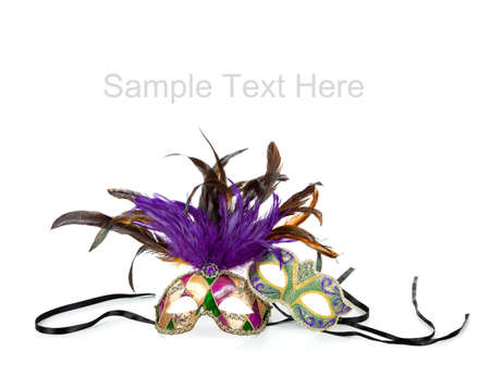 masquerade masks: Purple, green and gold mardi gras masks on a white background with copy space