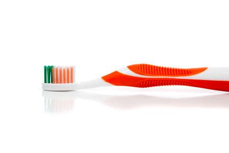An orange toothbrush on a white background  Stock Photo