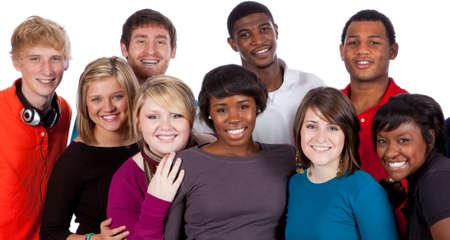 multi race: Un grupo multirracial de estudiantes universitarios sobre un fondo blanco Foto de archivo