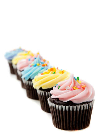 Pastel cupcakes including blue, pink and yellow on a white background with copy space Stock Photo - 6768458