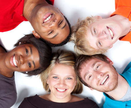 multi racial group: Close-up of faces of Multi-racial college students lying on the ground