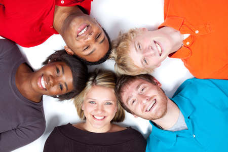 Close-up of faces of Multi-racial college students lying on the ground