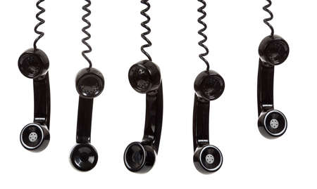 five black hanging telephone receivers on a white background Stock Photo - 6768485
