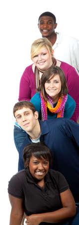 multi race: Una pila de estudiantes multirraciales sobre un fondo blanco