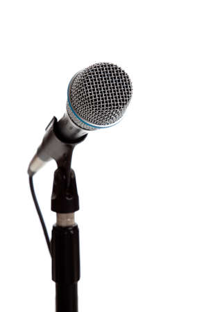 A white microphone on a white background with copy space photo