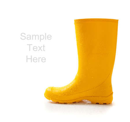 yellow: A pair of yellow rainboots  on a white background with copy space