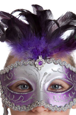 A girl in a purple madi gras mask on a white background photo