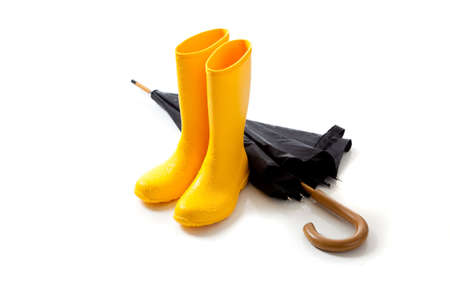 A pair of yellow rainboots and a black umbrella on a white background Stock fotó - 6843229