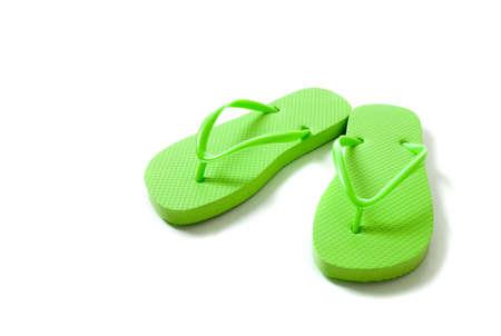 Green flipflops on a white background Reklamní fotografie