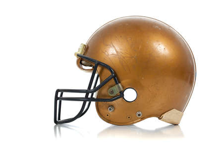 A gold football helmber on a white background