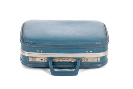 An old blue suitcase on a white background