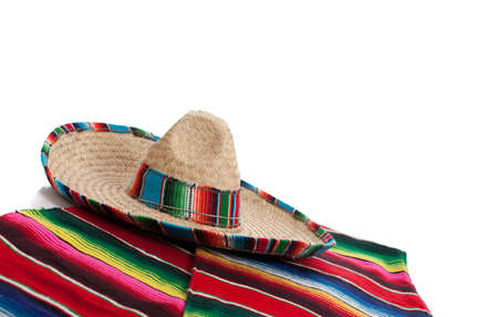 poncho: Mexican Serape and a sombrero on a white background with copy space