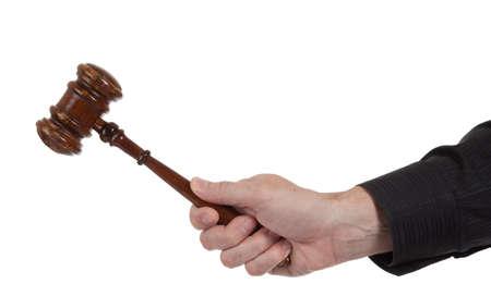 order in the court: Un holdking de mano un martillo marr�n sobre un fondo blanco Foto de archivo