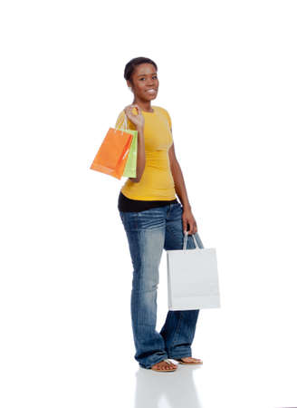 Young african-American lady with shopping bags Stock Photo - 9671316