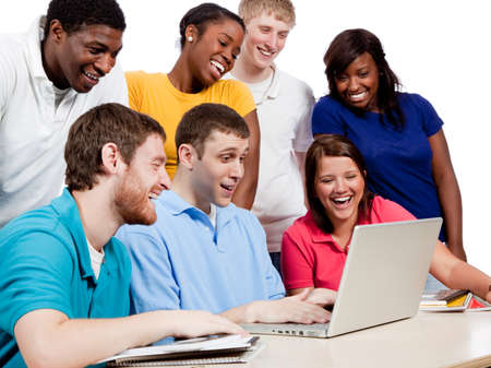 Multicultural College students, male and female, gathered around a computer photo