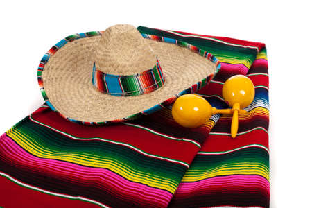 hispanics mexicans: Mexican Serape, sombrero and yellow maracas on a white background