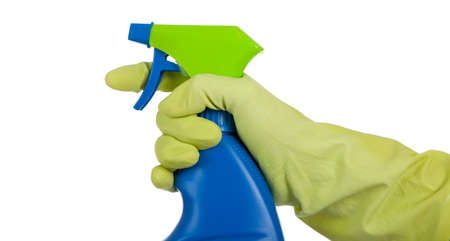 Yellow gloved hand with blue and green spray bottle