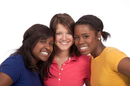 een multiculturele groep van mooie vrouwelijke studenten op een witte achtergrond
