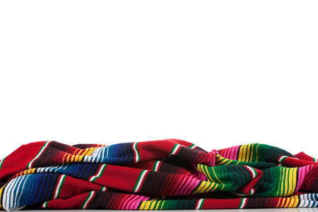 white blanket: Mexican Serape on a white background with copy space Stock Photo