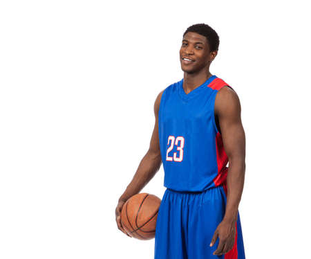 A young african American basketball player in a blue uniform on a white background