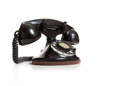 retro telephone: A black antique telephone on a white background with copy space