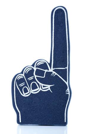 """numero uno: Un dedo de espuma azul, deportes memorbalia que significa """"somos el número uno!"""" Foto de archivo"""