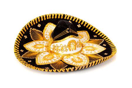 mariachi: Een zwarte en gouden mariachi sombrero op witte achtergrond