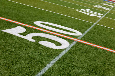 The 50 yard line of an American football field photo