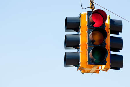 A red light traffic signal with blue sky copy space 스톡 콘텐츠