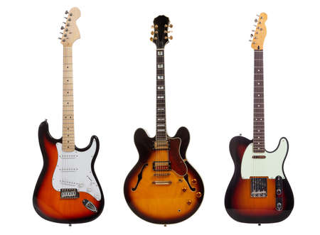 A group of three electric guitars on a white background